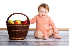 Child with apples in wicker basket. Isolated on white background. Autumn concept. Stock Photography