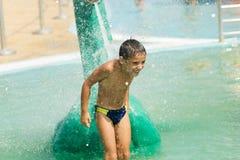 Child at aqua park. Smiling boy having fun at aqua park Royalty Free Stock Photography