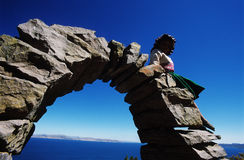 Child on arch. From Amantany Island - Titicaca Lake - Peru Royalty Free Stock Images