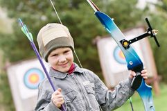 Child Archer with bow and arrows Royalty Free Stock Images
