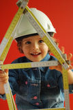 Child Architect. Beautiful little girl is making plans for construction of the house Stock Image