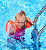 Child with armbands in swimming pool Stock Photos