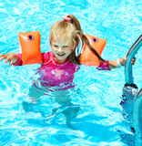Child with armbands in swimming pool Stock Photography