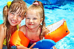 Child with armbands in swimming pool Royalty Free Stock Photo