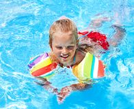 Child with armbands in swimming pool. Summer outdoor Royalty Free Stock Photos