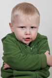 Child with arms crossed. Little child looking defiant and upset Royalty Free Stock Photos