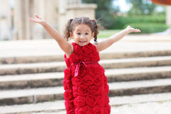 Child with arms outstretched. Image of a young girl with arms outstretched royalty free stock images