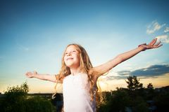 Child with arms outstretched royalty free stock photos