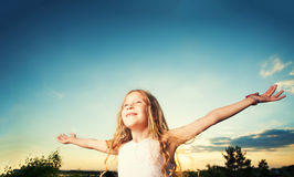Child with arms outstretched Royalty Free Stock Image