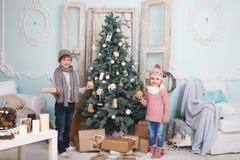 Child around the Christmas tree Stock Images