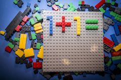Child arranges block of constructor. a childhood game that develops the imagination of small people. Colorful designer in the hands of a toddler. fun for kids Stock Photo