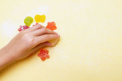 The child arranges marmalade figurines in a marine style. Stock Image