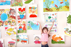 Child in art class with picture. Royalty Free Stock Photography