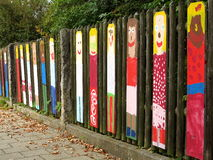 Child art paintings on wooden fence Stock Photos