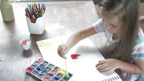 Child artist painting watercolor paints stock footage