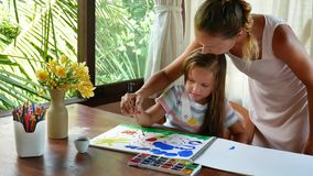 Child artist painting watercolor paints stock video