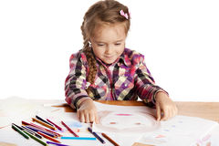 Child - artist paints picture Stock Photography