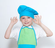 Child as a chef cook Stock Photography