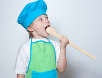 Child as a chef cook Stock Images