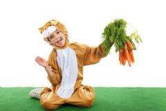 Child as easter hare with carrots Royalty Free Stock Photos