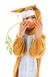 Child as easter hare with carrots Royalty Free Stock Photo