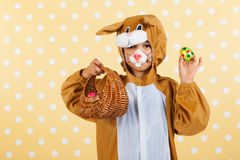 Child as easter hare with eggs Royalty Free Stock Image