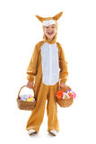 Child as easter hare with eggs and flowers Stock Photo