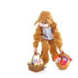 Child as easter hare with eggs and flowers Stock Photos