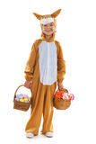 Child as easter hare with eggs and flowers Stock Image