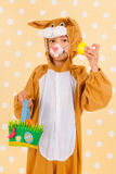 Child as easter hare with eggs Royalty Free Stock Photos