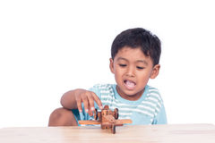 child asian boy playing wooden plane Royalty Free Stock Photo