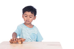 Child asian boy playing wooden plane Royalty Free Stock Photos