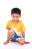 Child asian little boy preschool sitting on floor. Cute child asian little boy preschool sitting on floor stock images