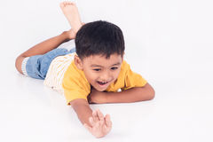 Child asian little boy smile and laying on floor Stock Photos