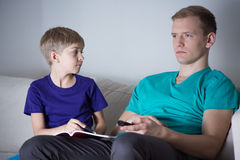 Child asking dad for help Royalty Free Stock Photo
