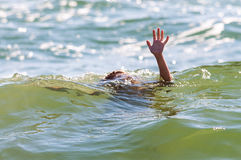 Help hand sign rescue child sinking Stock Images