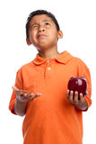 Child Asking for Wisdom to Choose Food Royalty Free Stock Photos