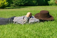 Child asleep in the grass Stock Photo