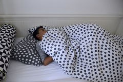 The child asleep in the night. Stock Photography