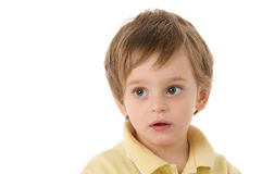 Child with astonished gaze. Portrait on white background Stock Photos