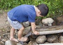 Child At Water Stream Stock Photo