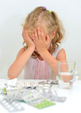 Child ate tablets. Dangerous situation at home royalty free stock image