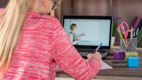 A child attends an online school during quarantine