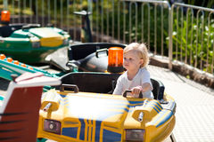 Child on the attraction Royalty Free Stock Images