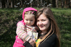 Child and aunt. Little child with her aunt Stock Photos