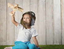 Child with aurplane on reen gras Stock Image