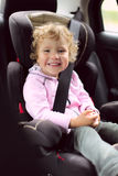 Child in an automobile armchair Royalty Free Stock Image