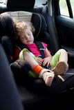 Child in an automobile armchair Stock Images
