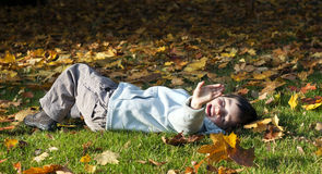 Child in autumn Royalty Free Stock Photos