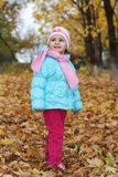 Child in autumn Stock Photos